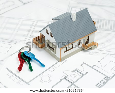 Buying a house\ House on blueprint and keys