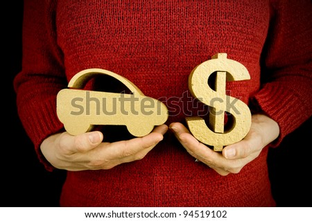 buying car, woman holding gold car and dollar