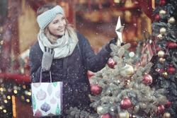buying Christmas gifts girl snow outside the bag
