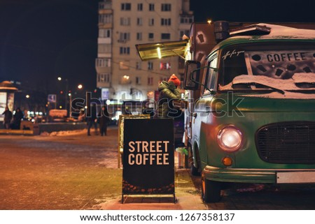 buying coffee in a mobile truck on wheels in the winter night