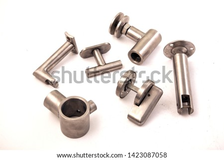 Buying now Industry Industry Group Composition Conceptual Photo Shoot Made of Stainless Stainless Chrome Objects on White Background.