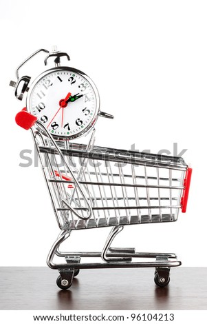 Buying time concept with clock and shopping cart