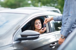 Buying used car. Car Dealer Inventory. Used cars store. Male wants to buy the car. Close-up of hand with a wrist watch, holding key from auto, finance for car concept. Happy life. Blurred background.