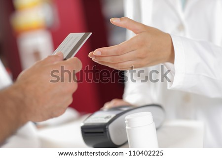 Buying with Credit Card in the Pharmacy. - stock photo