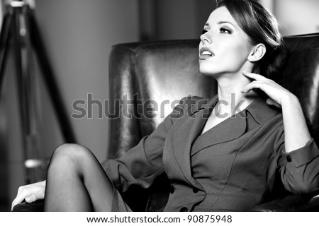 BW portrait of a young business woman in an office