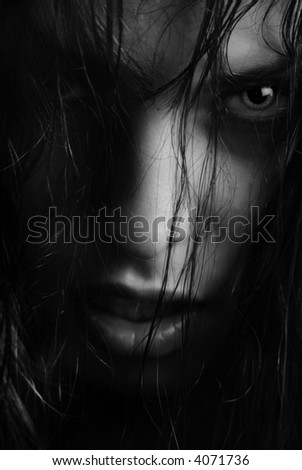 BW portrait of the angry witch-woman with wet hairs
