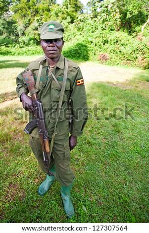 BWINDI, UGANDA - OCTOBER 22: Unidentified national park ranger on October 22, 2012 in the Bwindi National Park, Uganda. The Bwindi National Park is the most famous tourist attraction in Uganda. #127307564