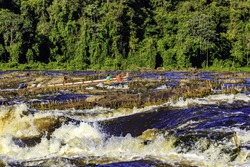 By boat through the Rapids of Surinam