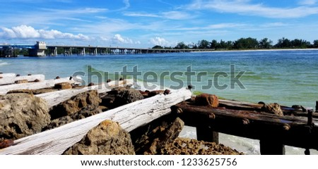By the Dock of the Bay Theme; Beautiful Blue-Green Ocean Waters Near a Local Bridge and Vintage Dock