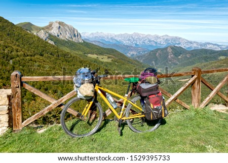 bycicle touring and landscape or cycling with saddlebags or byclicle pilgrim
