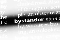bystander word in a dictionary. bystander concept.