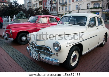 BYTOM, POLAND - SEPTEMBER 21: X Old Classic Car Parade. Cars are parked and admired by automotive enthusiasts. The parade was attended by about 100 cars on September 21, 2013 in Bytom, Poland.