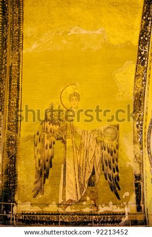 Byzantine mosaic of a Guardian Angel on a wall inside the Hagia Sophia in Istanbul, Turkey