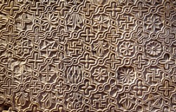 Byzantine patterned ornament carved in stone wall, ancient texture background, detail of interior with geometric relief. Symbols pattern inscribed on marble, decoration of Roman Greek architecture.