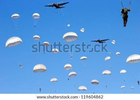 C-130 Hercules planes drop paratroopers
