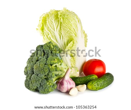cabbage broccoli, garlic, tomato and cucumber isolated on white background #105363254