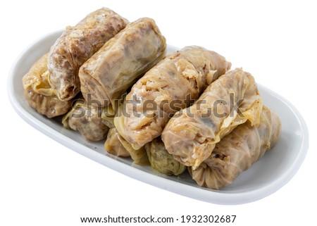 Cabbage wrap appetizer (mezze) isolated on white background. Healthy vegan food. Local name lahana sarması Stok fotoğraf ©