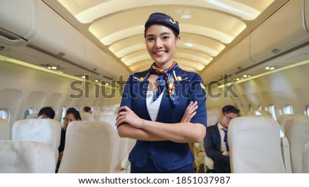 Cabin crew or air hostess working in airplane . Airline transportation and tourism concept. Stockfoto ©