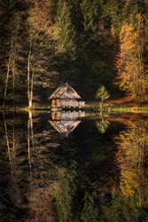 Cabin Home by the Lake Water Reflection in Trakoscan, Sunny Autumn Day in Nature