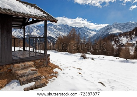 Cabin in a mountain valley in the North of Italy during winter. Brixia province, Lombardy region, Italy