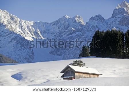Cabin in snow in front of Karwendel mountains Garmisch-Partenkirchen, Bavaria, Germany, Europe