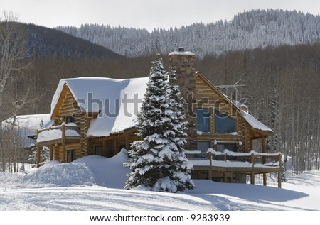 cabin in snow in mountains
