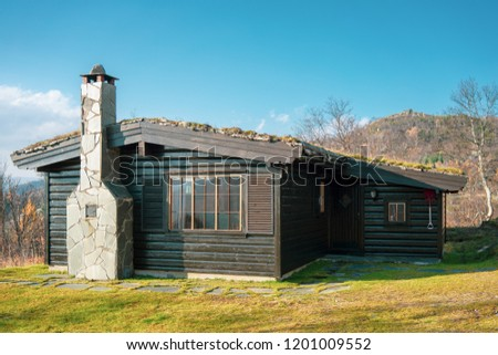 Cabin in the high mountain. The cabins are located in Sirdal, Norway. The picture is taken in nice autumn sun