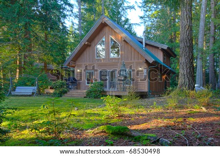 Cabin in the pine and fir forest with deck.