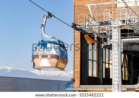 cabin lifts at a ski resort out of gondola station #1035482221