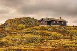Cabin on a rocky hill in Hardangervidda National Park, Norway