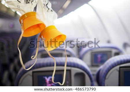 cabin oxygen mask drop from the cabin ceiling #486573790
