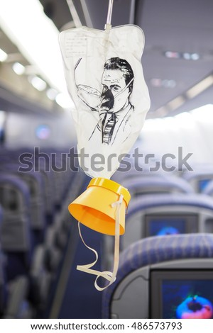cabin oxygen mask drop from the cabin ceiling #486573793