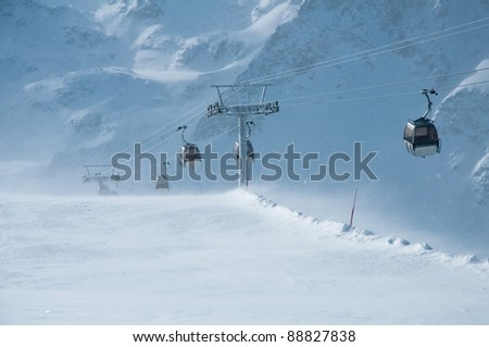 cabin ski lift in Alps mountains, winter