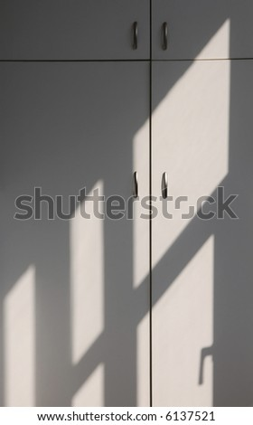 Cabinet and lines of sun light and shadow