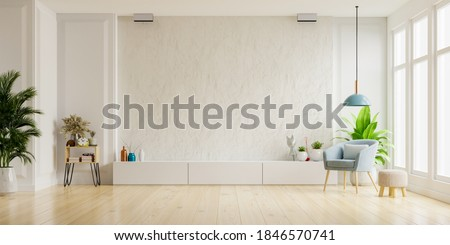 Cabinet for TV on the white plaster wall in living room with armchair,minimal design,3d rendering