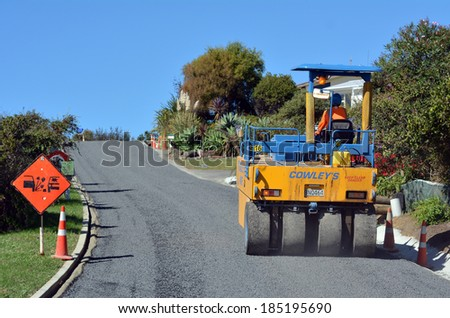 CABLE BAY, NZ - APR 01 2014:Road roller on asphalt pavement works (road repairing). There are more than four million miles of highways and roads in the U.S alone.