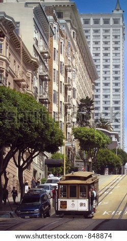 Cable car glides down a steep San Francisco street