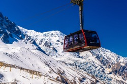 Cable car in snowy mountains in Chamonix, Mont Blanc, Haute-Savoie, France