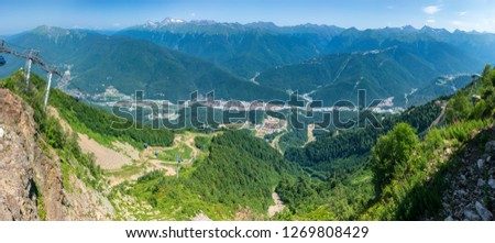 Cable car in the mountain. View over the Green Valley residential houses, surrounded by high mountains. Nature background. #1269808429