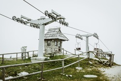 Cable car station in mountains in fog. Velika Planina, Slovenia, Europe.