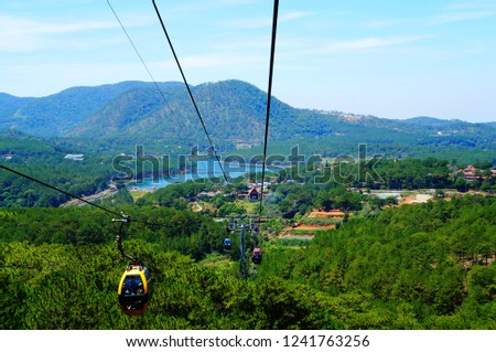 Cable car taking tourists from Da Lat to Tyen Lam Lake and Truc Lam Temple. Vietnam, Southeast Asia #1241763256