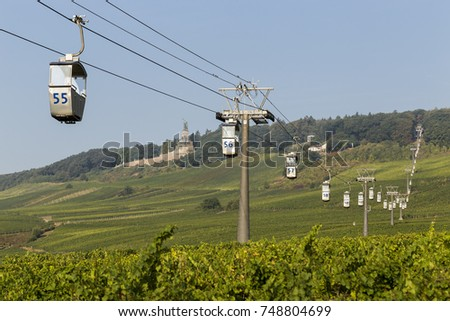 Cable car to Niederwald Monument passes over a field of Riesling grapes In the German town of Ruedesheim am Rhein, in the Rheingau Wine Region.