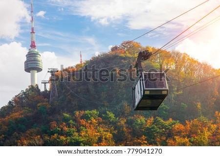 Cable car to Seoul N tower with blue sky and autymn season, Seoul city, South Korea #779041270