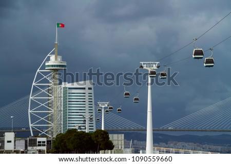 Cable car, Vasco da Gama tower and Vasco da Gama Bridge (Ponte Vasco de Gama)  in Lisbon, Portugal #1090559660