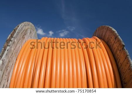 Cable drum fiber against blue sky
