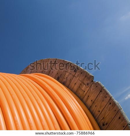 Cable drum with blue sky,