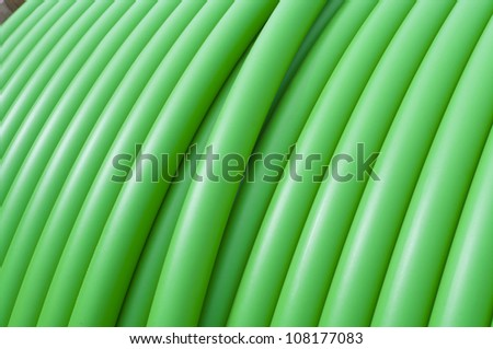 cable drum with green cable on it - stock photo