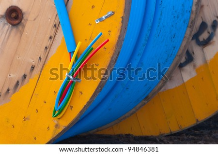 cable on cable drum containing four cables in different colors