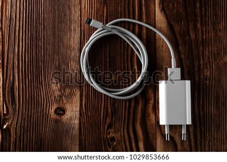 Cable phone chargers on wood background #1029853666