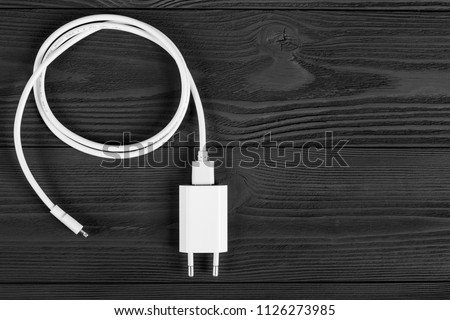 Cable phone chargers on wood background #1126273985